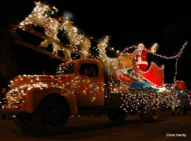 Lighted Santa Claus tractor outside at the Calistoga lighted tractor parade.