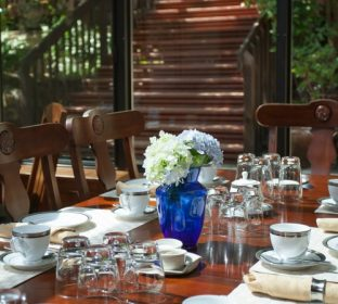 View of breakfast sun room dining table at the Calistoga Wine Way Inn in the Napa Valley Wine Country