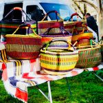Woven colorful baskets for sale at the Calistoga Farmer's Market in the Napa Valley; Wine Country